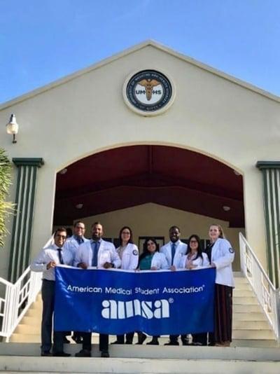 UMHS AMSA: (left to right) Mohan Kumar, Jann Vale Hernandez, Sean Velavallil, Cochranlee Villanueva, Mariliz Davila, Shep Draytorn, Coraly Rivera Martinez, Nicole Winkelmann. Photo: Courtesy of AMSA