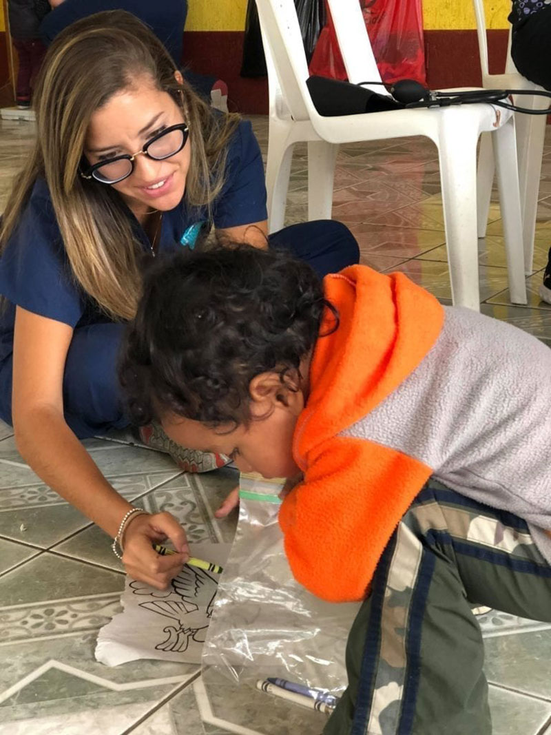 Med4You member Ariana Hernandez playing with one of the pediatric patients from Santa Lucia Milpas Altas, Guatemala. Photo: UMHS Med4You