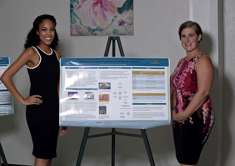 Christina Varela (left) & Dr. Jane Harrington. Christina gave a poster presentation on 'Detection of Salmonella & E.coli contamination from imported & domestically produced poultry from retail markets in St. Kitts'. © Ian Holyoak Photography