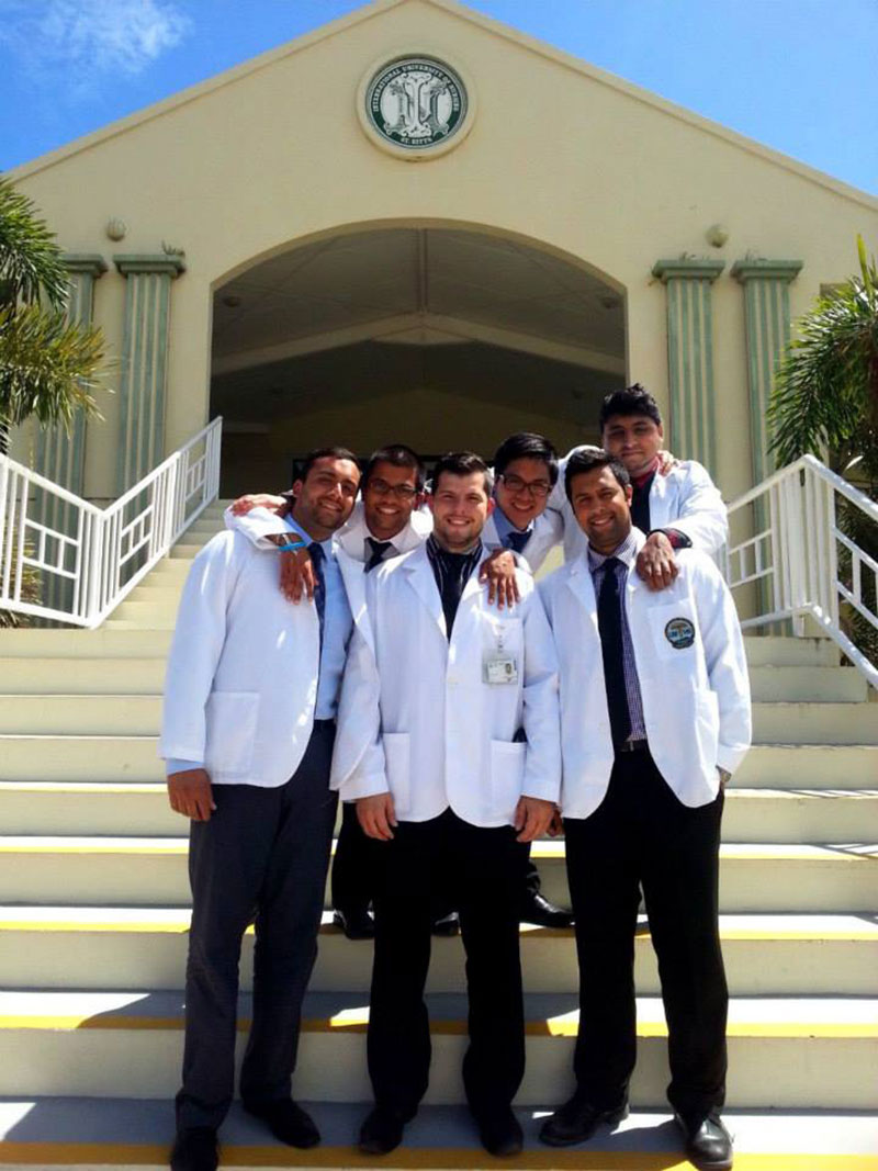 DR. MANOCHA AT UMHS: Last semester in St. Kitts with friends. Photo: Courtesy of Dr. Rohan Manocha