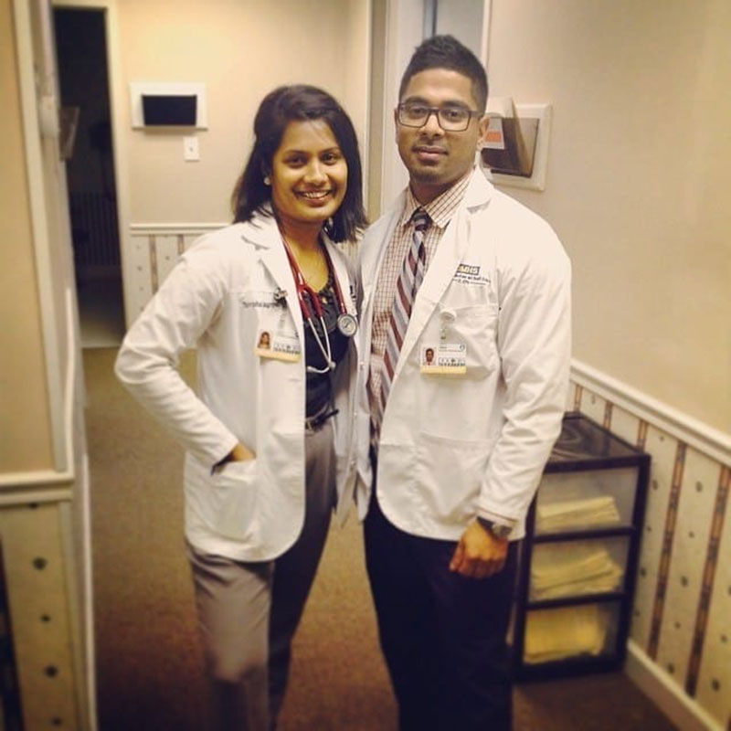 DR. RAJAGOPAL & DR. PATHMALINGAM: 'After USMLE Step 1 & beginning of first clinical rotation. This is Family Medicine outpatient clinic of Dr. Henderson, the woman who inspired me to become a Family Medicine doctor. Augusta, GA.' Photo: Courtesy of Dr. Thivisa Rajagopal
