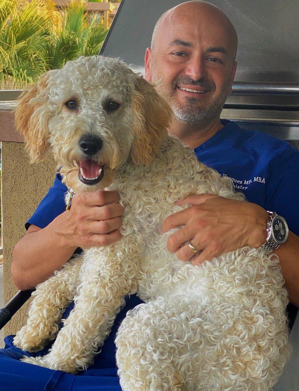Dr Aaron Vazquez with dog
