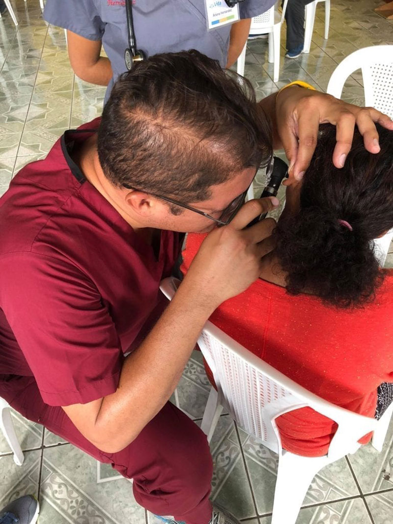 Dr. Angel Matos doing an ear examination in a patient from Santa Lucia Milpas Altas, Guatemala. Photo: UMHS Med4You