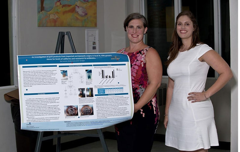 Dr. Harrington with (right) Ellen Lorenzen. Ellen did a poster presentation on 'An investigation of pork products from imported & domestic origins in local St. Kitts grocery stores for levels of coliforms & resistance to antibiotics.' Photo: © Ian Holyoak Photography