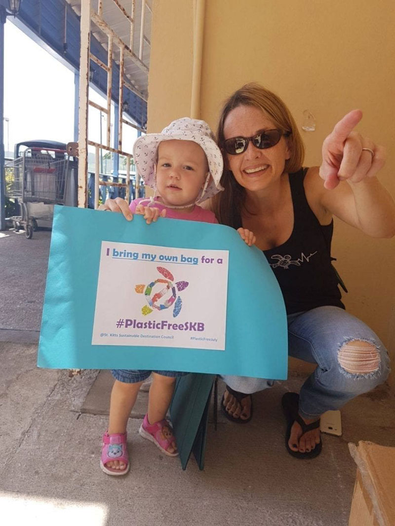 Dr. Kimberly Stewart, founder and director of the St. Kitts Sea Turtle Monitoring Network, and daughter Jess, show their support of a Plastic Free St. Kitts. Photo: Courtesy of SDC/Heart of St. Kitts Foundation