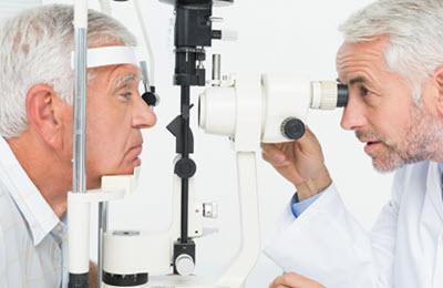 ophthalmology Eye Doctor at a slit lamp performing eye exam