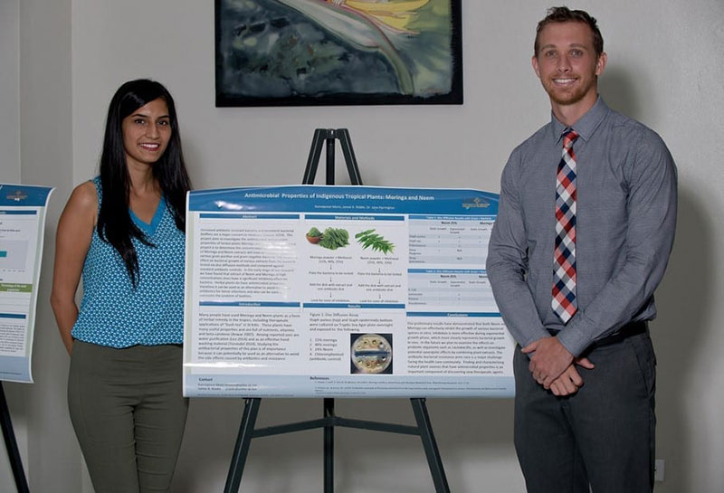 Kamalpreet Mann & James K. Riddle did a poster presentation on 'Antimicrobial properties of indigenous tropical plants Moringa & Neem.' Photo: © Ian Holyoak Photography