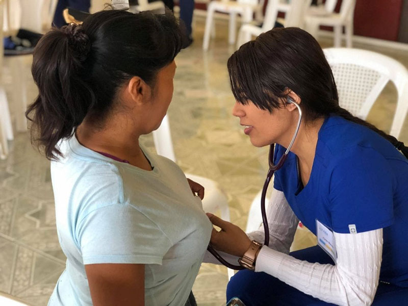 Med4You member Karen Nieves (right) doing a cardiac examination in Santa Lucia Milpas Altas community in Guatemala. Photo: UMHS Med4You