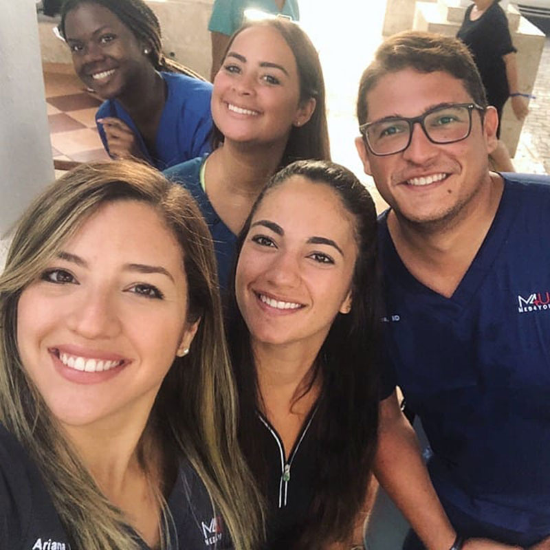 MED4YOU UMHS TEAM: UMHS student Ariana Hernandez (far left) created the nonprofit Med4You & Dr. Matos (far right) helped her also turn it into a student organization. Med4You took UMHS students on medical missions to Guatemala, Puerto Rico & the Dominican Republic. Also pictured: (center) UMHS students & Med4You members Paola Mora & (top center) Endrina Mangual & (top left, in blue) Pryia Simmons. Photo: Courtesy of UMHS Med4You