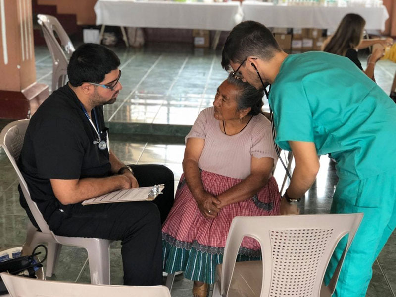 Med4You members Carlos Meija & Jiomar Santiago doing a medical history & physical examination of a patient in the Magadalena Milpas Altas community in Guatemala. Photo: UMHS Med4You