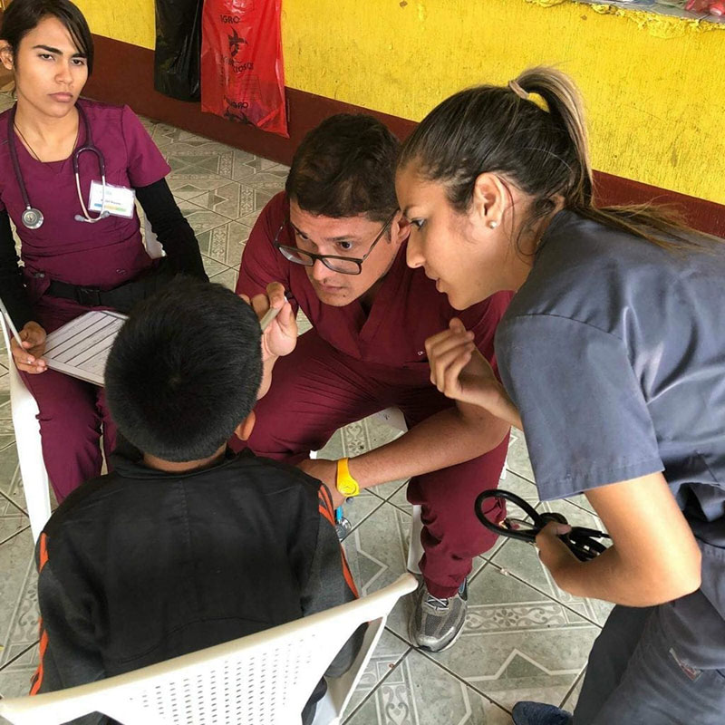 (Left to right) Karen Nieves, Dr. Angel Matos & Ariana Hernandez helping a child from Santa Lucia Milpas Altas, Guatemala. Photo: UMHS Med4You