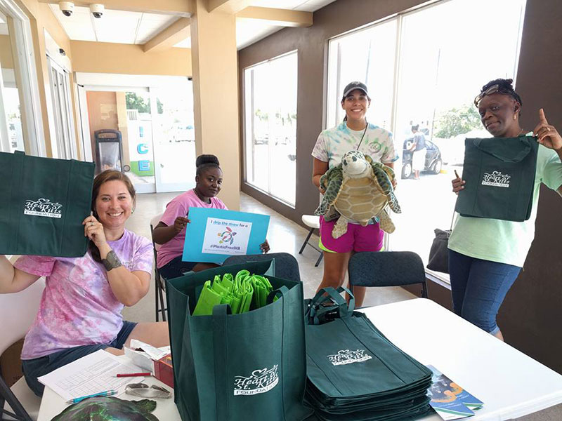 PART OF THE SOLUTION: SDC, St. Kitts Sea Turtle Monitoring Network, & Heart of St. Kitts representatives are all smiles at the reusable bag and outreach events during Plastic-Free July. Photo: Courtesy of SDC/Heart of St. Kitts Foundation