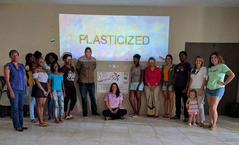 'PLASTICIZED': Supporters of Plastic-Free July attend a screening of the documentary 'Plasticized' in St. Kitts. Dr. Julie Graves of UMHS (in red blouse, second in righthand row) was interviewed for this post. Click here to see a brief video interview with Dr. Graves. Photo: Courtesy of SDC/Heart of St. Kitts Foundation