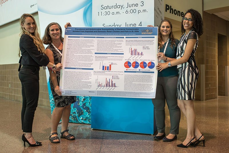 """PRESENTING STUDY IN NEW ORLEANS: (left to right) UMHS researchers Beani Forst, Dr. Jane Harrington, Ellen Lorenzen & Christina Varela presented the study """"Prevalence and Antimicrobial Susceptibility of Bacterial Contaminate Isolated from Imported and Domestic Retail Chicken and Pork in St. Kitts."""" Photo: Ian Holyoak Photography"""