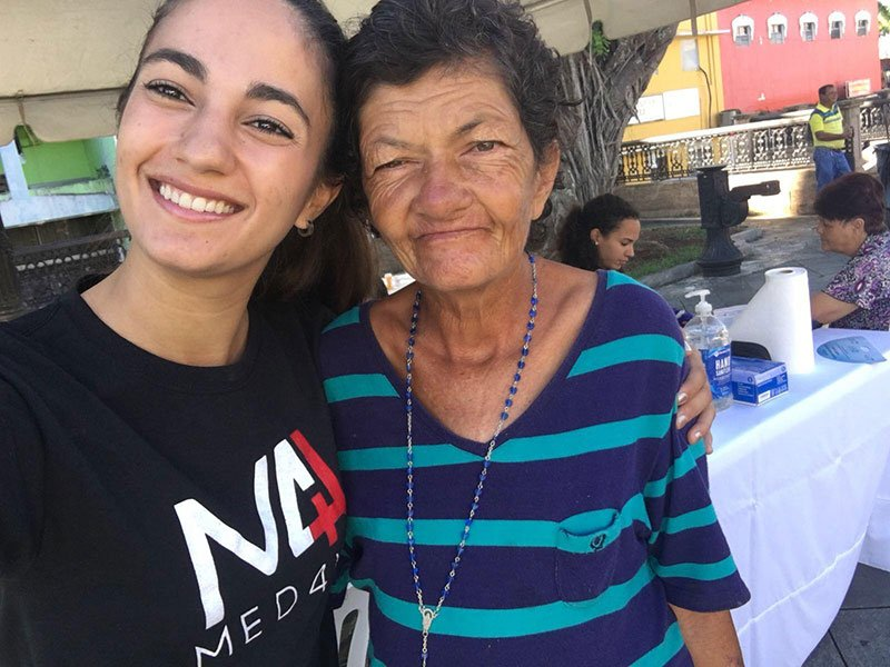 This patient (right) asked UMHS student & Med4You Vice President Paola Mora for a selfie because she wanted Paola to not forget how she helped her. Photo: UMHS Med4You