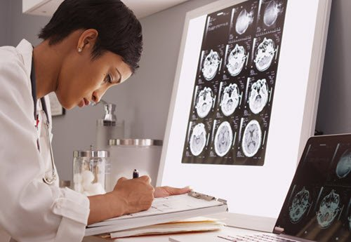 Radiology resident reviewing imaging