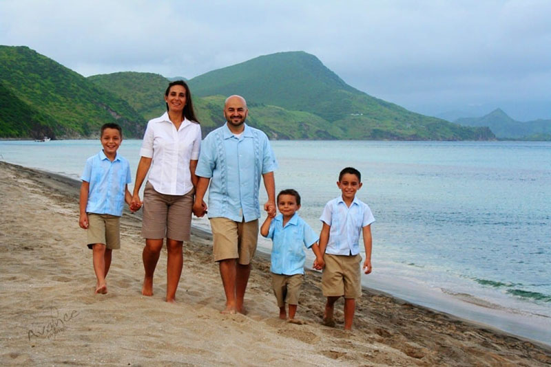 THE VAZQUEZ FAMILY: Wife Esther (center, left) & Dr. Aaron Vazquez with their kids in St. Kitts