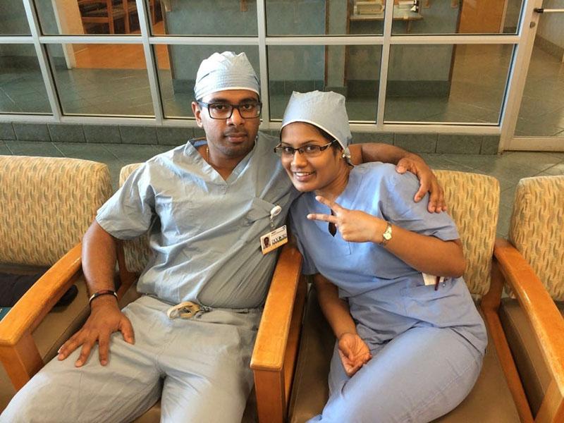 THUSAN & THIVISA TAKING A BREAK: 'Surgery rotation with Dr. Cochrane at Doctor's Hospital, Augusta, GA.' Photo: Courtesy of Dr. Thivisa Rajagopal