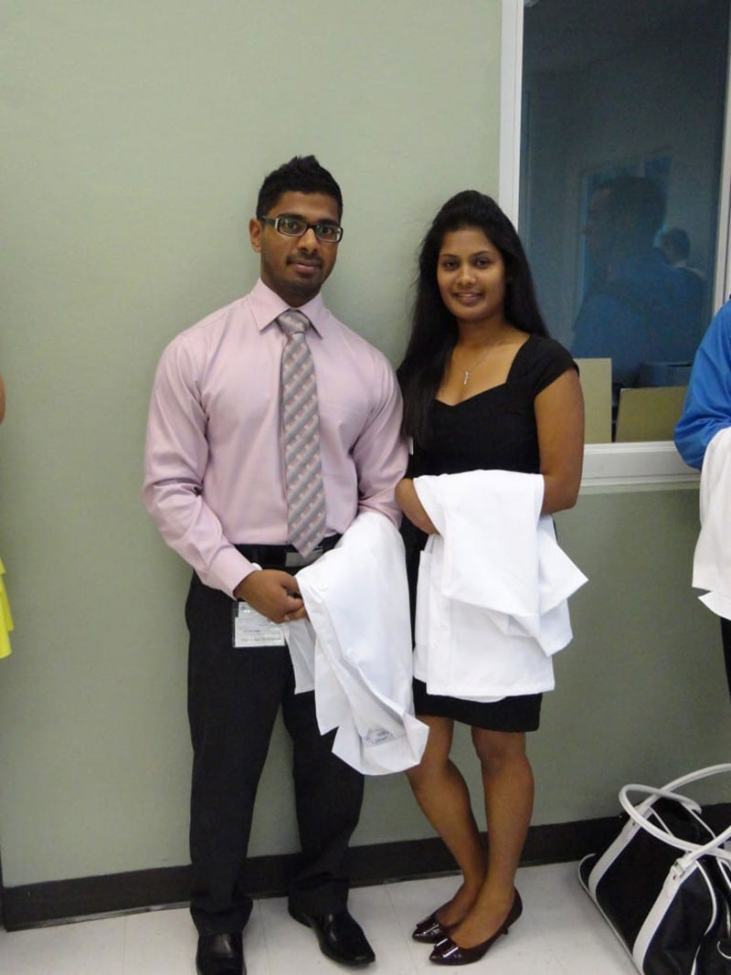 THUSHAN & THIVISA: 'At the library of UMHS, St. Kitts, lining up for the white coat ceremony & oath.' Photo: Courtesy of Dr. Thivisa Rajagopal