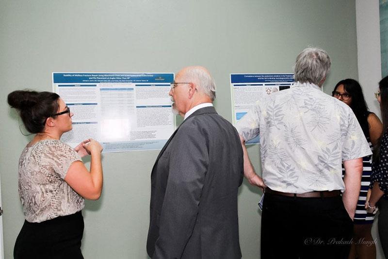 SECOND ANNUAL UMHS RESEARCH SYMPOSIUM: (Left to right) Adrianna Thibault, UMHS Dean Edwin Purcell, Dr. Dave Herrick, Patricia Rivera & Lyanna Santana. Photo: Dr. Prakash Mungli
