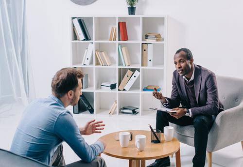 black male psychiatrist with patient