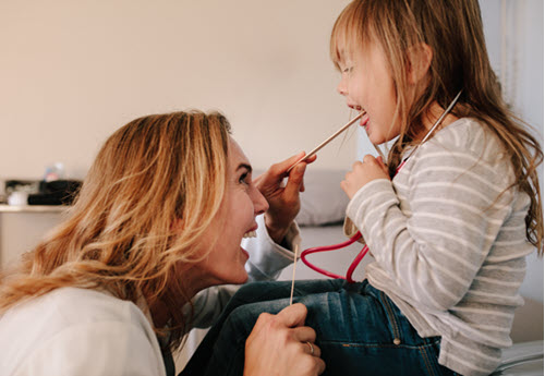 female childrens doctor with child