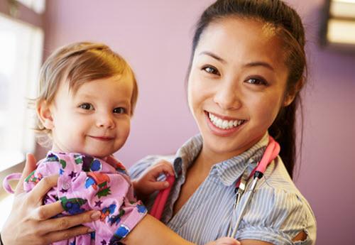 happy pediatrics specialist with a child