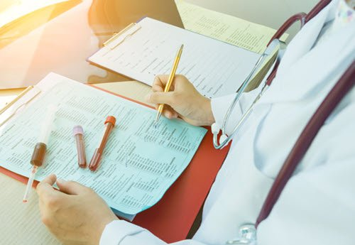 hematology oncology physician with blood samples