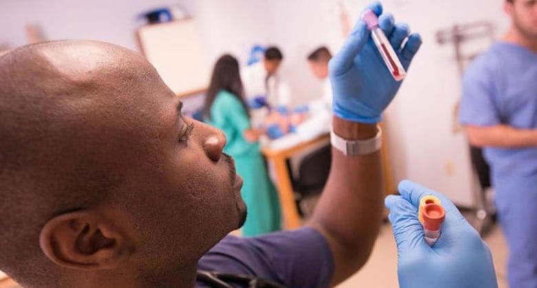 medical-student-examining-blood-sample
