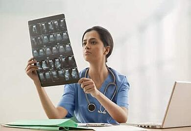 physician looking at ultrasound