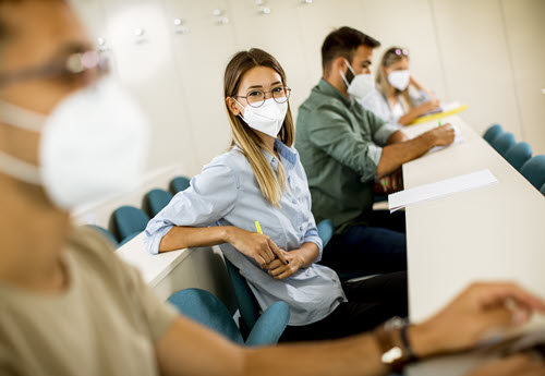student in class with mask
