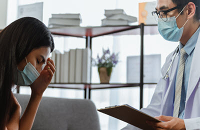 woman with brain fog at doctor