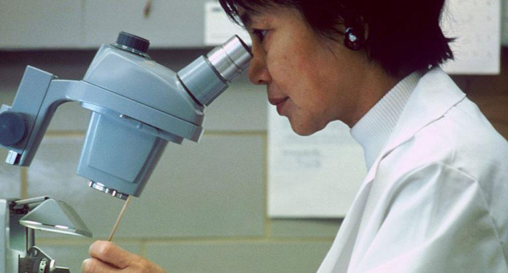 Scientist_looking_thorugh_microscope